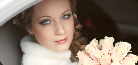 Beautiful bride woman portrait with bridal bouquet posing on her wedding day Mahogany