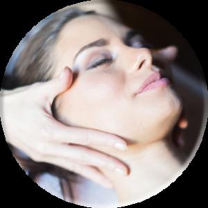 woman having a relaxing facial massage