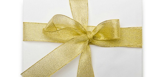Promotions mahogany Envelope with colourful ribbon on white
